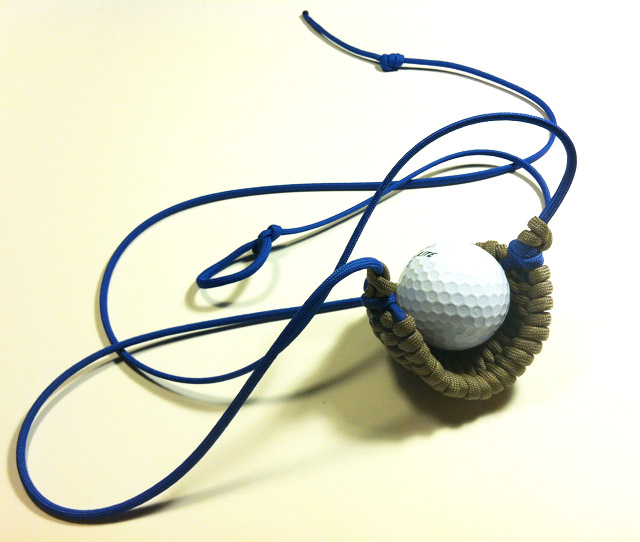 30_inches_Paracord_Sling_made_by_David_the_Shepherd--blue_cords_tan_pouch.jpg